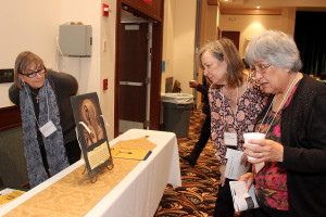 Ladies viewing the picture of OUr Lady that was a silent auction item.