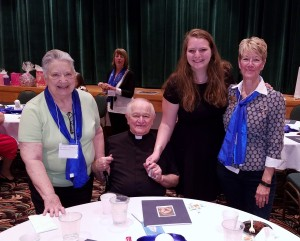 Carol Woitchek, ACCW scholarship committee head, with Father Michalicka, scholarship winner Hayden Zehrung, and Mary Ann Schmitt, ACCW President at the ACCW Bi-ennial convention April 23, 2016 at the Pastoral Center